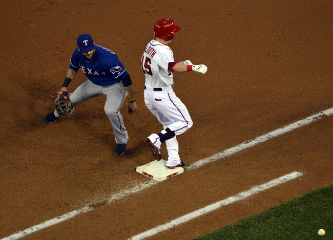 May 30, 2014; Washington, DC, USA; Washington Nationals left fielder Nate McLouth (15) reaches first bases on a throwing error during the fourth inning against the Texas Rangers   at Nationals Park. Mandatory Credit: Tommy Gilligan-USA TODAY Sports