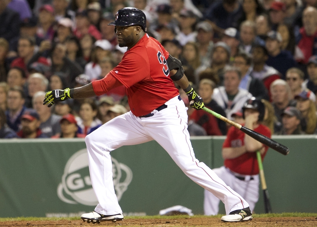 May 30, 2014; Boston, MA, USA; Boston Red Sox designated hitter David Ortiz (34) gets a hit to drive in a run against the Tampa Bay Rays during the fifth inning at Fenway Park. Mandatory Credit: David Butler II-USA TODAY Sports