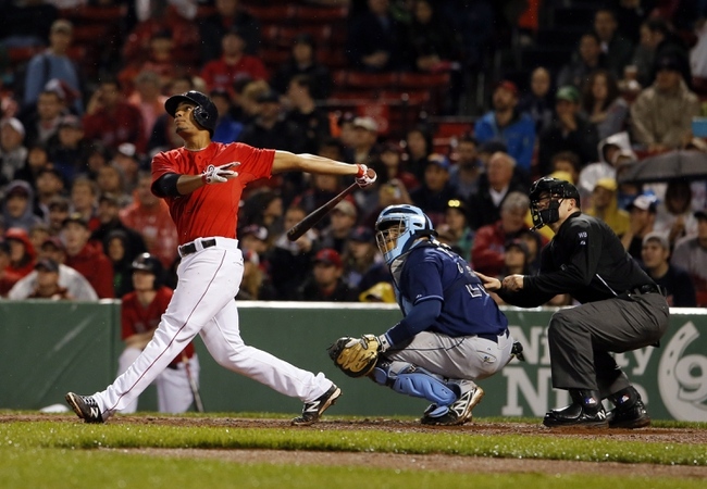 May 30, 2014; Boston, MA, USA; Boston Red Sox shortstop Xander Bogaerts (2) hits a double driving in a run to tie the game against the Tampa Bay Rays during the seventh inning at Fenway Park. Mandatory Credit: David Butler II-USA TODAY Sports