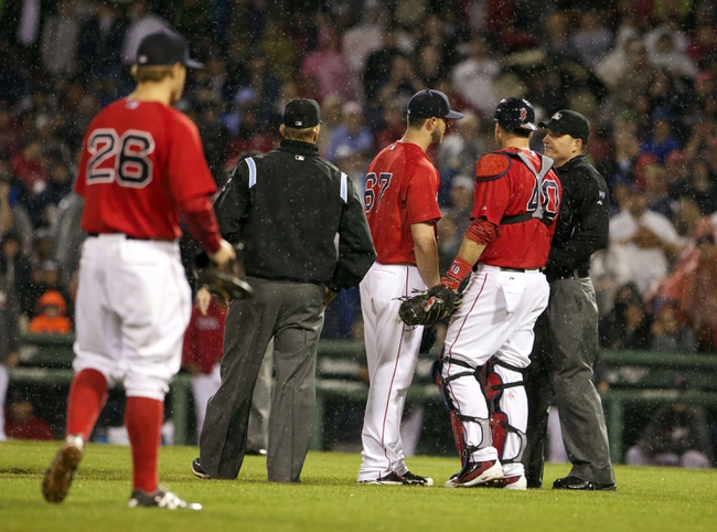 May 30, 2014; Boston, MA, USA; Boston Red Sox starting pitcher Brandon Workman (67) is ejected from the game after hitting Tampa Bay Rays third baseman Evan Longoria (3) during the sixth inning at Fenway Park. Mandatory Credit: David Butler II-USA TODAY Sports