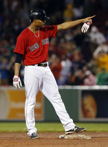 May 30, 2014; Boston, MA, USA; Boston Red Sox shortstop Xander Bogaerts (2) reacts after hitting a double driving in a run to tie the game against the Tampa Bay Rays during the seventh inning at Fenway Park. Mandatory Credit: David Butler II-USA TODAY Sports