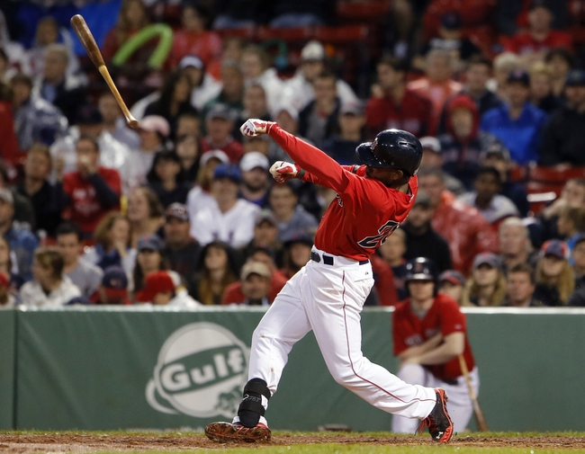 May 30, 2014; Boston, MA, USA; Boston Red Sox center fielder Jackie Bradley Jr. (25) loses his bat as the Sox take on the Tampa Bay Rays during the ninth inning at Fenway Park. Mandatory Credit: David Butler II-USA TODAY Sports