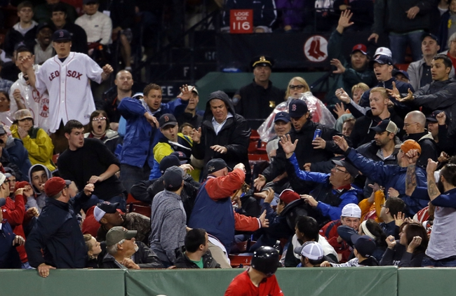 May 30, 2014; Boston, MA, USA; The Crowd reacts after Boston Red Sox center fielder Jackie Bradley Jr. (not pictured) looses his bat as the Sox take on the Tampa Bay Rays during the ninth inning at Fenway Park. Mandatory Credit: David Butler II-USA TODAY Sports
