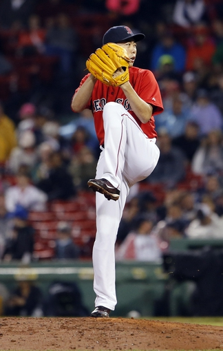 May 30, 2014; Boston, MA, USA; Boston Red Sox relief pitcher Koji Uehara (19) throws a pitch against the Tampa Bay Rays during the ninth inning at Fenway Park. Mandatory Credit: David Butler II-USA TODAY Sports
