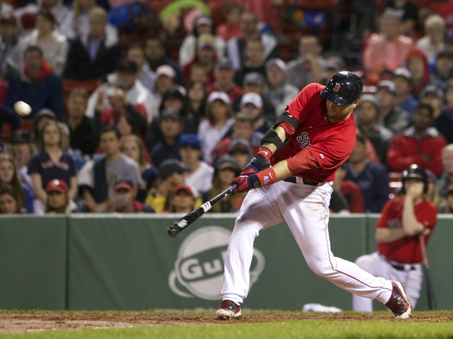 May 30, 2014; Boston, MA, USA; Boston Red Sox catcher A.J. Pierzynski (40) gets a hit to drive in the winning run against the Tampa Bay Rays during the tenth inning at Fenway Park. Mandatory Credit: David Butler II-USA TODAY Sports