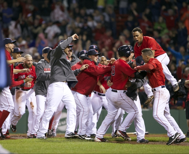 May 30, 2014; Boston, MA, USA; Boston Red Sox left fielder Jonny Gomes (5) and teammates celebrates after scoring the winning run on a base hit by catcher A.J. Pierzynski (40) against the Tampa Bay Rays during the tenth inning at Fenway Park. The Boston Red Sox defeated Tampa Bay Rays 3-2. Mandatory Credit: David Butler II-USA TODAY Sports