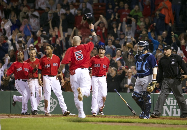 May 30, 2014; Boston, MA, USA; Boston Red Sox left fielder Jonny Gomes (5) celebrates as he scores the winning run on a base hit by catcher A.J. Pierzynski (not pictured) against the Tampa Bay Rays during the tenth inning at Fenway Park. The Boston Red Sox defeated Tampa Bay Rays 3-2. Mandatory Credit: David Butler II-USA TODAY Sports