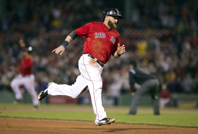 May 30, 2014; Boston, MA, USA; Boston Red Sox left fielder Jonny Gomes (5) runs the bases scoring the winning run on a base hit by catcher A.J. Pierzynski (40) against the Tampa Bay Rays during the tenth inning at Fenway Park. The Boston Red Sox defeated Tampa Bay Rays 3-2. Mandatory Credit: David Butler II-USA TODAY Sports