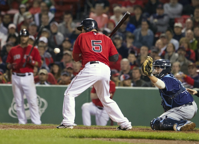 May 30, 2014; Boston, MA, USA; Boston Red Sox left fielder Jonny Gomes (5) is hit by a pitch from Tampa Bay Rays relief pitcher Juan Carlos Oviedo (not pictured) during the tenth inning at Fenway Park. The Boston Red Sox defeated Tampa Bay Rays 3-2. Mandatory Credit: David Butler II-USA TODAY Sports