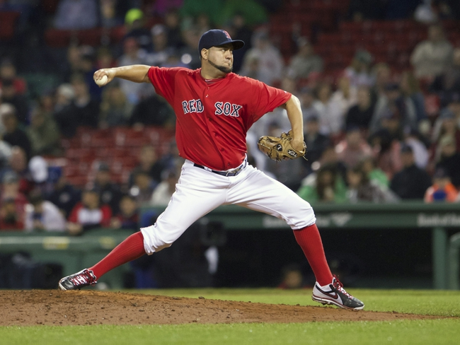 May 30, 2014; Boston, MA, USA; Boston Red Sox relief pitcher Edward Mujica (54) throws a pitch against the Tampa Bay Rays during the tenth inning at Fenway Park. The Boston Red Sox defeated Tampa Bay Rays 3-2. Mandatory Credit: David Butler II-USA TODAY Sports