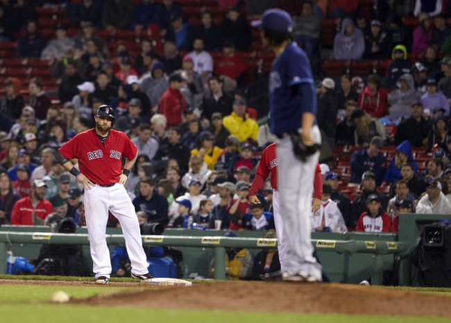May 30, 2014; Boston, MA, USA; Boston Red Sox left fielder Jonny Gomes (5) reacts after being hit by a pitch from Tampa Bay Rays relief pitcher Juan Carlos Oviedo (46) during the tenth inning at Fenway Park. The Boston Red Sox defeated Tampa Bay Rays 3-2. Mandatory Credit: David Butler II-USA TODAY Sports