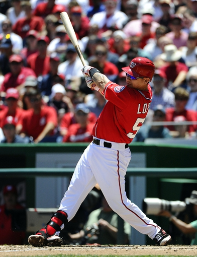 May 31, 2014; Washington, DC, USA; Washington Nationals catcher Jose Lobaton (59) hits a two run home run against the Texas Rangers during the second inning at Nationals Park. Mandatory Credit: Brad Mills-USA TODAY Sports