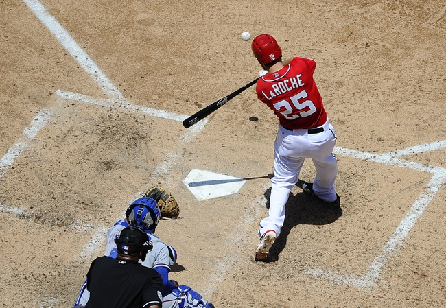 May 31, 2014; Washington, DC, USA; Washington Nationals first baseman Adam LaRoche (25) hits a three run home run against the Texas Rangers during the fourth inning at Nationals Park. Mandatory Credit: Brad Mills-USA TODAY Sports
