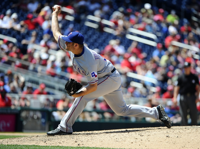 May 31, 2014; Washington, DC, USA; Texas Rangers relief pitcher Shawn Tolleson (37) throws during the seventh inning against the Washington Nationals at Nationals Park. Mandatory Credit: Brad Mills-USA TODAY Sports