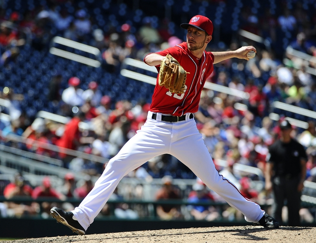 May 31, 2014; Washington, DC, USA; Washington Nationals relief pitcher Jerry Blevins (13) throws against the Texas Rangers during the ninth inning at Nationals Park. Mandatory Credit: Brad Mills-USA TODAY Sports