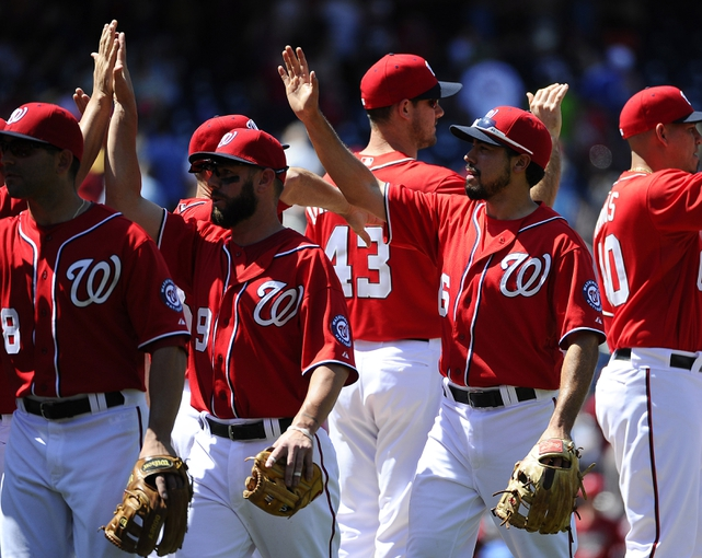 May 31, 2014; Washington, DC, USA; Washington Nationals third baseman Anthony Rendon (6) is congratulated by teammates after the final out against the Texas Rangers at Nationals Park. Mandatory Credit: Brad Mills-USA TODAY Sports