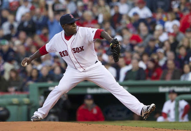 May 31, 2014; Boston, MA, USA; Boston Red Sox starting pitcher Rubby De La Rosa (62) throws the ball against the Tampa Bay Rays in the second inning at Fenway Park. Mandatory Credit: David Butler II-USA TODAY Sports