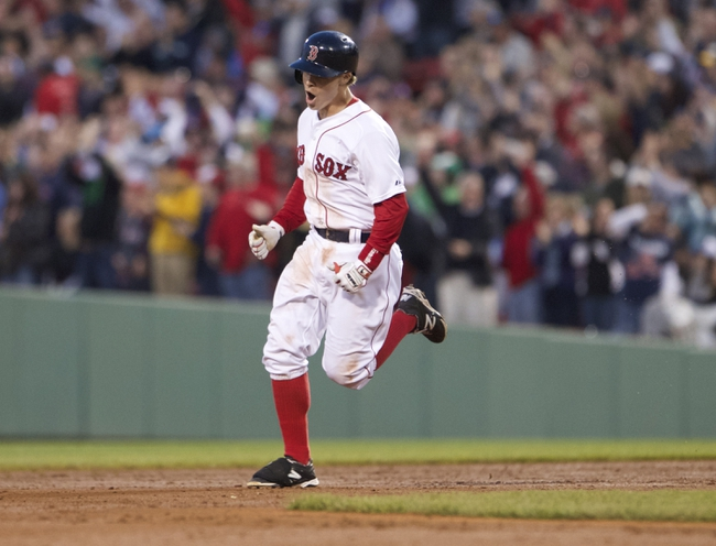 May 31, 2014; Boston, MA, USA; Boston Red Sox third baseman Brock Holt (26) hits a two run home-run against the Tampa Bay Rays in the third inning at Fenway Park. Mandatory Credit: David Butler II-USA TODAY Sports