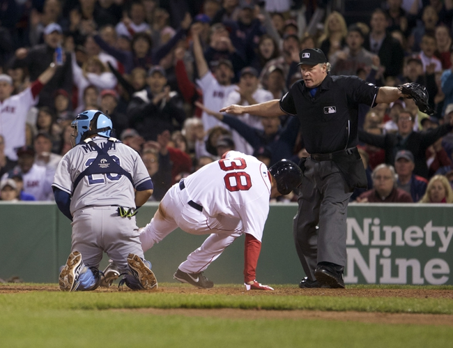 May 31, 2014; Boston, MA, USA; Boston Red Sox left fielder Grady Sizemore (38) scores on a bunt by second baseman Jonathan Herrera (10) (not pictured) against Tampa Bay Rays catcher Jose Molina (28) in the fourth inning at Fenway Park. Mandatory Credit: David Butler II-USA TODAY Sports