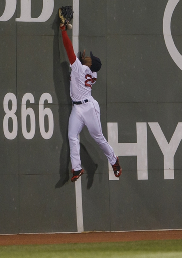 May 31, 2014; Boston, MA, USA; Boston Red Sox center fielder Jackie Bradley Jr. (25) reaches for the ball against the Tampa Bay Rays in the eighth inning at Fenway Park. Mandatory Credit: David Butler II-USA TODAY Sports