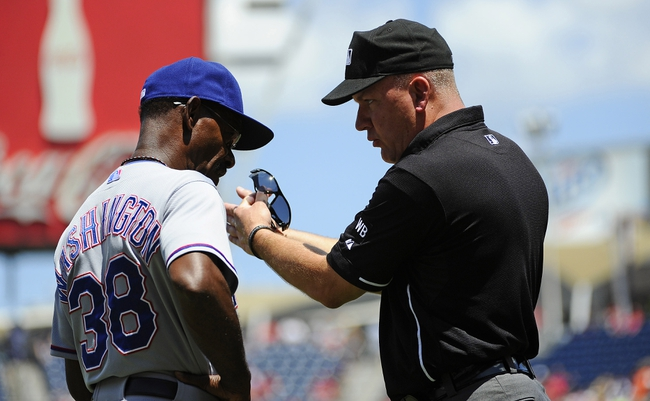 Jun 1, 2014; Washington, DC, USA; Umpire Jeff Nelson explains a call to Texas Rangers manager Ron Washington during the first inning at Nationals Park. Mandatory Credit: Brad Mills-USA TODAY Sports