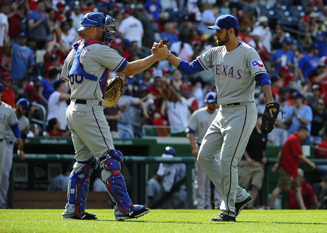 Jun 1, 2014; Washington, DC, USA; Texas Rangers relief pitcher Joakim Soria (28) is congratulated by Texas Rangers catcher Chris Gimenez (60) after earning a save against the Washington Nationals at Nationals Park. The Rangers won 2-0. Mandatory Credit: Brad Mills-USA TODAY Sports
