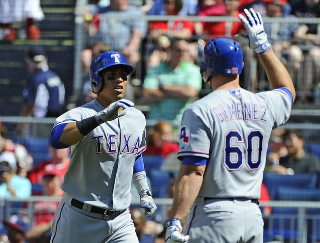 Jun 1, 2014; Washington, DC, USA; Texas Rangers center fielder Leonys Martin (2) is congratulated by Texas Rangers catcher Chris Gimenez (60) after hitting a solo home run against the Washington Nationals during the seventh inning at Nationals Park. The Rangers won 2-0. Mandatory Credit: Brad Mills-USA TODAY Sports