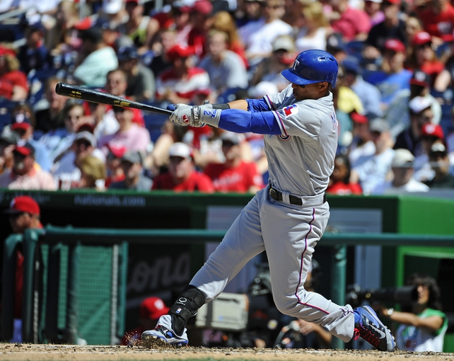 Jun 1, 2014; Washington, DC, USA; Texas Rangers center fielder Leonys Martin (2) hits a solo home run against the Washington Nationals during the seventh inning at Nationals Park. The Rangers won 2-0. Mandatory Credit: Brad Mills-USA TODAY Sports