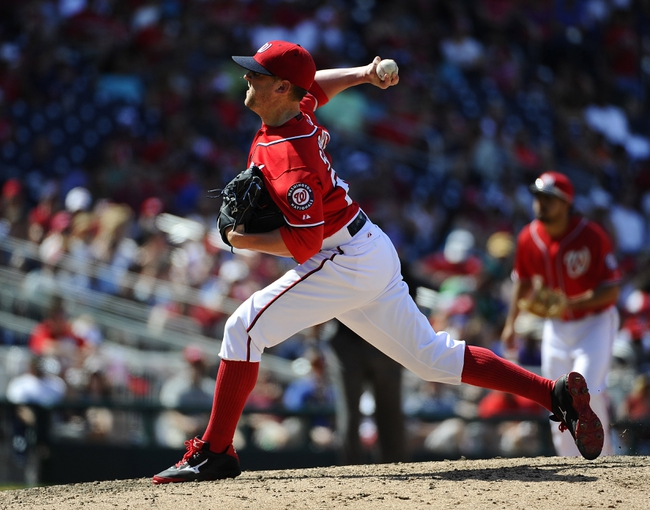 Jun 1, 2014; Washington, DC, USA; Washington Nationals relief pitcher Drew Storen (22) throws to the Texas Rangers during the eighth inning at Nationals Park. The Rangers won 2-0. Mandatory Credit: Brad Mills-USA TODAY Sports