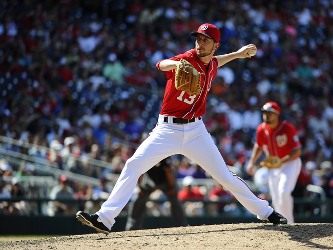 Jun 1, 2014; Washington, DC, USA; Washington Nationals relief pitcher Jerry Blevins (13) throws during the eighth inning against the Texas Rangers at Nationals Park. Mandatory Credit: Brad Mills-USA TODAY Sports