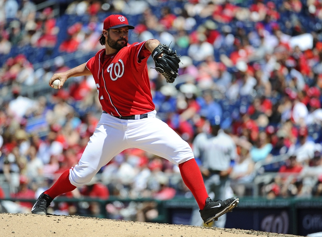 Jun 1, 2014; Washington, DC, USA; Washington Nationals starting pitcher Tanner Roark (57) throws during the fifth inning against the Texas Rangers at Nationals Park. Mandatory Credit: Brad Mills-USA TODAY Sports