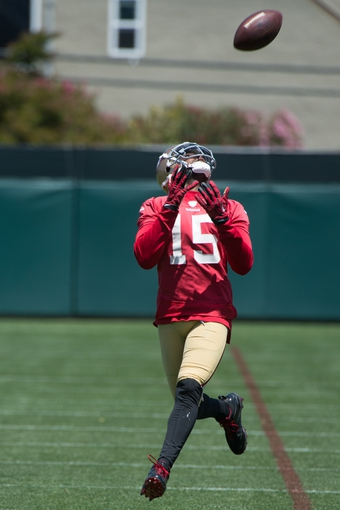 May 28, 2014; Santa Clara, CA, USA; San Francisco 49ers wide receiver Michael Crabtree (15) during organized team activities at the SAP Performance Facility. Mandatory Credit: Kyle Terada-USA TODAY Sports