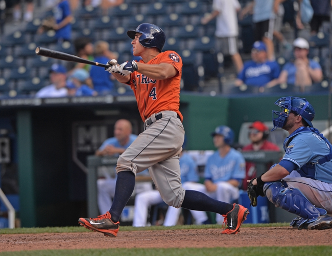 May 28, 2014; Kansas City, MO, USA; Houston Astros right fielder George Springer (4) at bat against the Kansas City Royals during the ninth inning at Kauffman Stadium. Mandatory Credit: Peter G. Aiken-USA TODAY Sports
