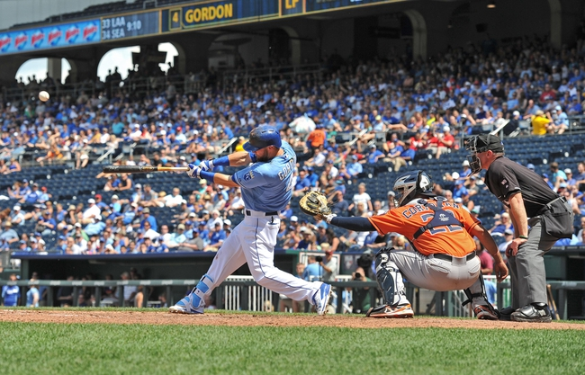 May 28, 2014; Kansas City, MO, USA; Kansas City Royals left fielder Alex Gordon (4) hits a single against the Houston Astros during the first inning at Kauffman Stadium. Mandatory Credit: Peter G. Aiken-USA TODAY Sports