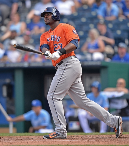 May 28, 2014; Kansas City, MO, USA; Houston Astros designated hitter Chris Carter (23) hits a three run home run against the Kansas City Royals during the sixth inning at Kauffman Stadium. Mandatory Credit: Peter G. Aiken-USA TODAY Sports