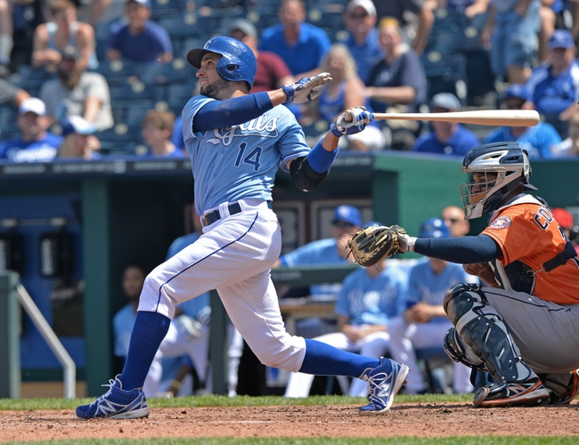 May 28, 2014; Kansas City, MO, USA; Kansas City Royals second basemen Omar Infante (14) drives in a run with a sacrifice fly against the Houston Astros during the fifth inning at Kauffman Stadium. Mandatory Credit: Peter G. Aiken-USA TODAY Sports