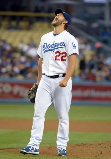 Jun 2, 2014; Los Angeles, CA, USA; Los Angeles Dodgers starter Clayton Kershaw (22) reacts after surrendering a two-run home run to Chicago White Sox first baseman Jose Abreau (not pictured) in the fourth inning at Dodger Stadium. Mandatory Credit: Kirby Lee-USA TODAY Sports