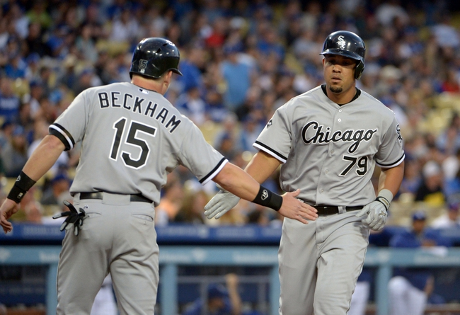 Jun 2, 2014; Los Angeles, CA, USA; Chicago White Sox first baseman Jose Abreu (79) is greeted by second baseman Gordon Beckham (15) after hitting a two-run home run in the fourth inning against the Los Angeles Dodgers at Dodger Stadium. Mandatory Credit: Kirby Lee-USA TODAY Sports