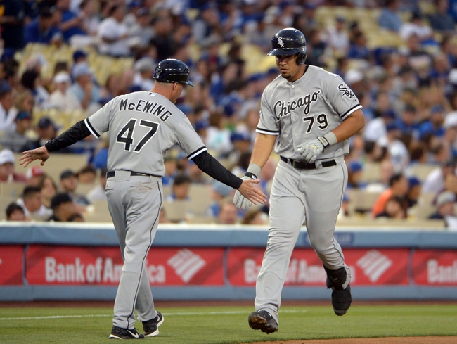 Jun 2, 2014; Los Angeles, CA, USA; Chicago White Sox first baseman Jose Abreu (79) is greeted by third base coach Joe McEwing (47) after hitting a two-run home run in the fourth inning against the Los Angeles Dodgers at Dodger Stadium. Mandatory Credit: Kirby Lee-USA TODAY Sports