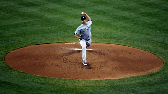 Jun 2, 2014; Los Angeles, CA, USA; Chicago White Sox starter Jose Quintana (62) delivers a pitch against the Los Angeles Dodgers at Dodger Stadium. Mandatory Credit: Kirby Lee-USA TODAY Sports