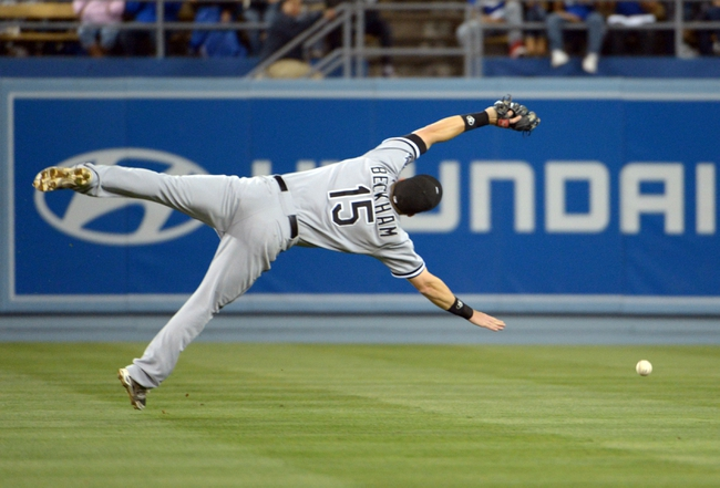 Jun 2, 2014; Los Angeles, CA, USA; Chicago White Sox second baseman Gordon Beckham (15) is unable to catch a two-run single flyball by Los Angeles Dodgers third baseman Justin Turner (not pictured) in the sixth inning at Dodger Stadium. The Dodgers defeated the White Sox 5-2. Mandatory Credit: Kirby Lee-USA TODAY Sports