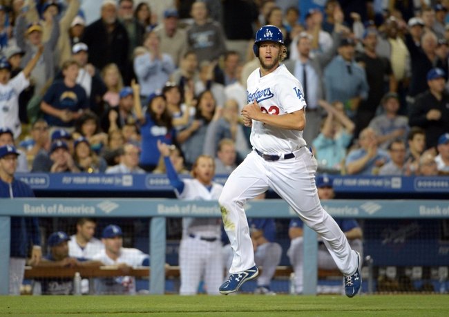 Jun 2, 2014; Los Angeles, CA, USA; Los Angeles Dodgers pitcher Clayton Kershaw (22) rounds third base to score in the sixth inning against the Chicago White Sox at Dodger Stadium. The Dodgers defeated the White Sox 5-2. Mandatory Credit: Kirby Lee-USA TODAY Sports
