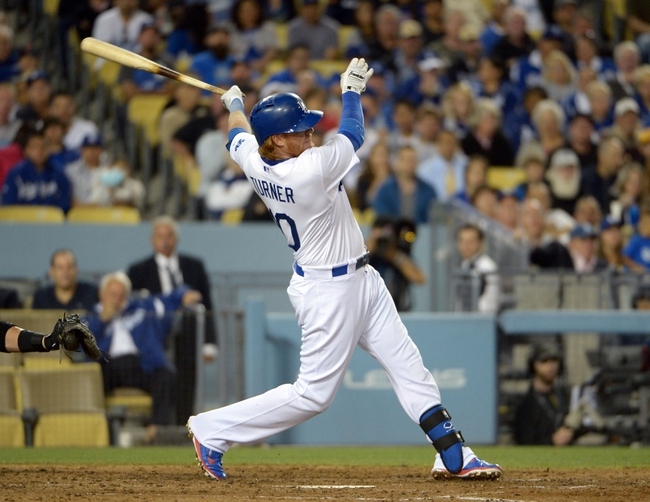 Jun 2, 2014; Los Angeles, CA, USA; Los Angeles Dodgers third baseman Justin Turner (10) follows through on a two-run single in the sixth inning against the Chicago White Sox at Dodger Stadium. The Dodgers defeated the White Sox 5-2. Mandatory Credit: Kirby Lee-USA TODAY Sports