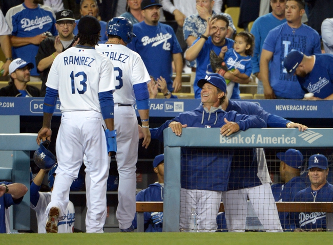 Jun 2, 2014; Los Angeles, CA, USA; Los Angeles Dodgers shortstop Hanley Ramirez (13) and first baseman Adrian Gonzalez (23) are greeted by manager Don Mattingly after scoring in the sixth inning against the Chicago White Sox at Dodger Stadium. The Dodgers defeated the White Sox 5-2. Mandatory Credit: Kirby Lee-USA TODAY Sports
