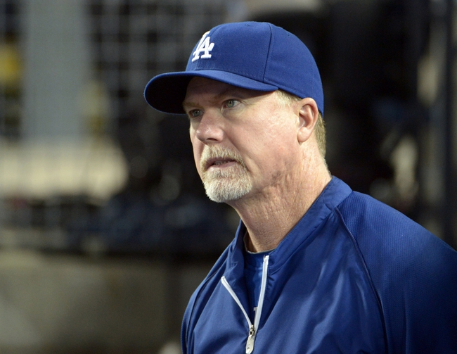 Jun 2, 2014; Los Angeles, CA, USA; Los Angeles Dodgers hitting coach Mark McGwire reacts in the ninth inning against the Chicago White Sox at Dodger Stadium. The Dodgers defeated the White Sox 5-2. Mandatory Credit: Kirby Lee-USA TODAY Sports