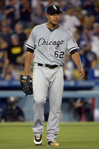 Jun 2, 2014; Los Angeles, CA, USA; Chicago White Sox pitcher Jose Quintana (62) reacts in the sixth inning against the Los Angeles Dodgers at Dodger Stadium. The Dodgers defeated the White Sox 5-2. Mandatory Credit: Kirby Lee-USA TODAY Sports