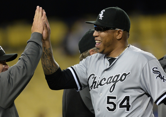 Jun 3, 2014; Los Angeles, CA, USA; Chicago White Sox relief pitcher Ronald Belisario (54) walks off the field after a save in the ninth inning of the game against the Los Angeles Dodgers at Dodger Stadium. White Sox won 4-1. Mandatory Credit: Jayne Kamin-Oncea-USA TODAY Sports