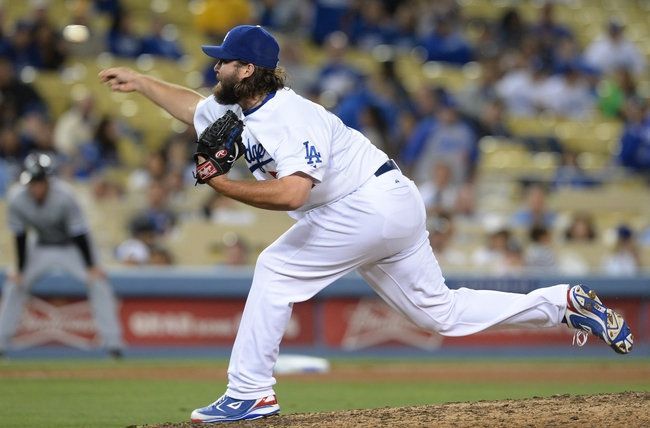 Jun 3, 2014; Los Angeles, CA, USA; Los Angeles Dodgers relief pitcher Chris Perez (54) in the eighth inning of the game against the Chicago White Sox at Dodger Stadium. White Sox won 4-1. Mandatory Credit: Jayne Kamin-Oncea-USA TODAY Sports