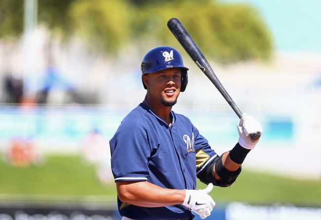 Mar 18, 2014; Phoenix, AZ, USA; Milwaukee Brewers outfielder Carlos Gomez against the Texas Rangers at Maryvale Baseball Park. Mandatory Credit: Mark J. Rebilas-USA TODAY Sports