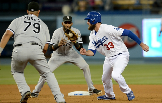 Jun 4, 2014; Los Angeles, CA, USA; Los Angeles Dodgers left fielder Scott Van Slyke (33) is caught in a run down play between Chicago White Sox first baseman Jose Abreu (79) and shortstop Alexei Ramirez (10) in the fourth inning of the game at Dodger Stadium. Mandatory Credit: Jayne Kamin-Oncea-USA TODAY Sports